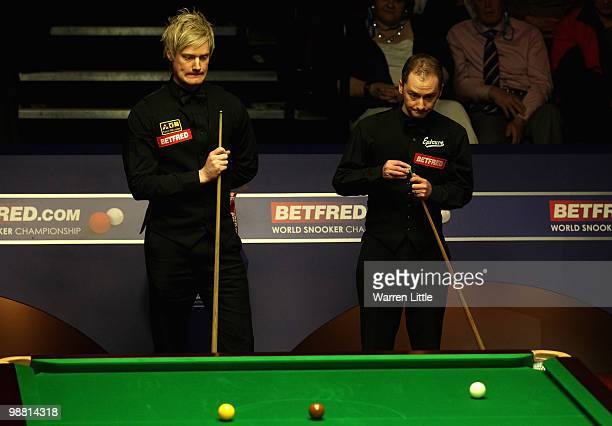 Graeme Dott of Scotland and Neil Robertson of Australia have a chat during the final of the Betfredcom World Snooker Championships at The Crucible...
