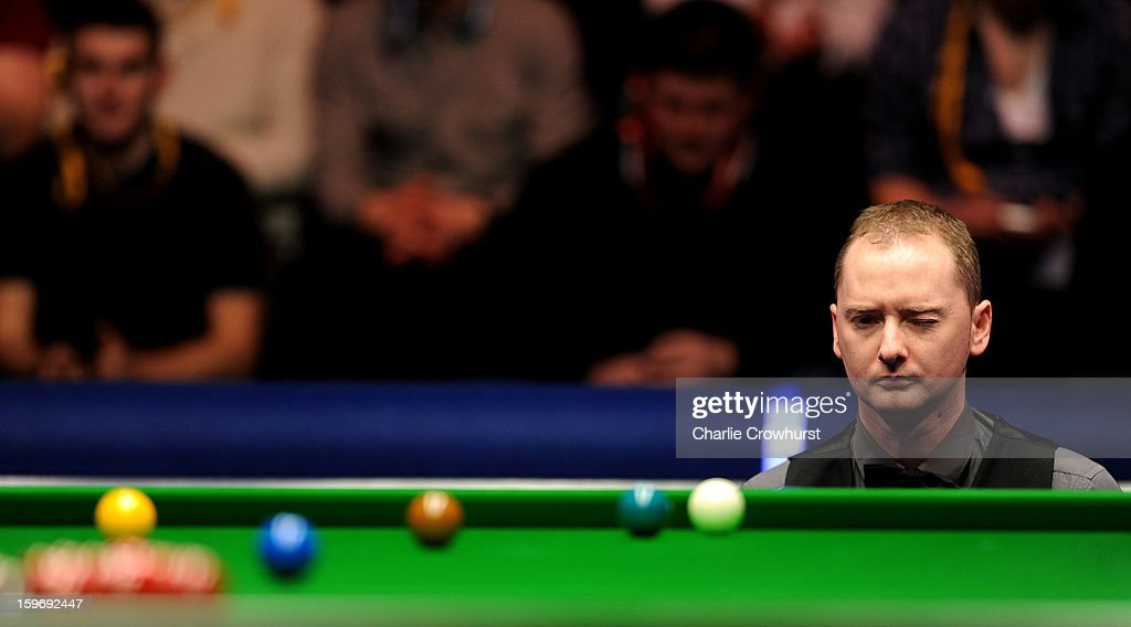 Graeme Dott of Scotland eyes up his next shot during his quarter-final match against Judd Trump of England on day 6 of The Masters at Alexandra Palace on January 18, 2013 in London England.