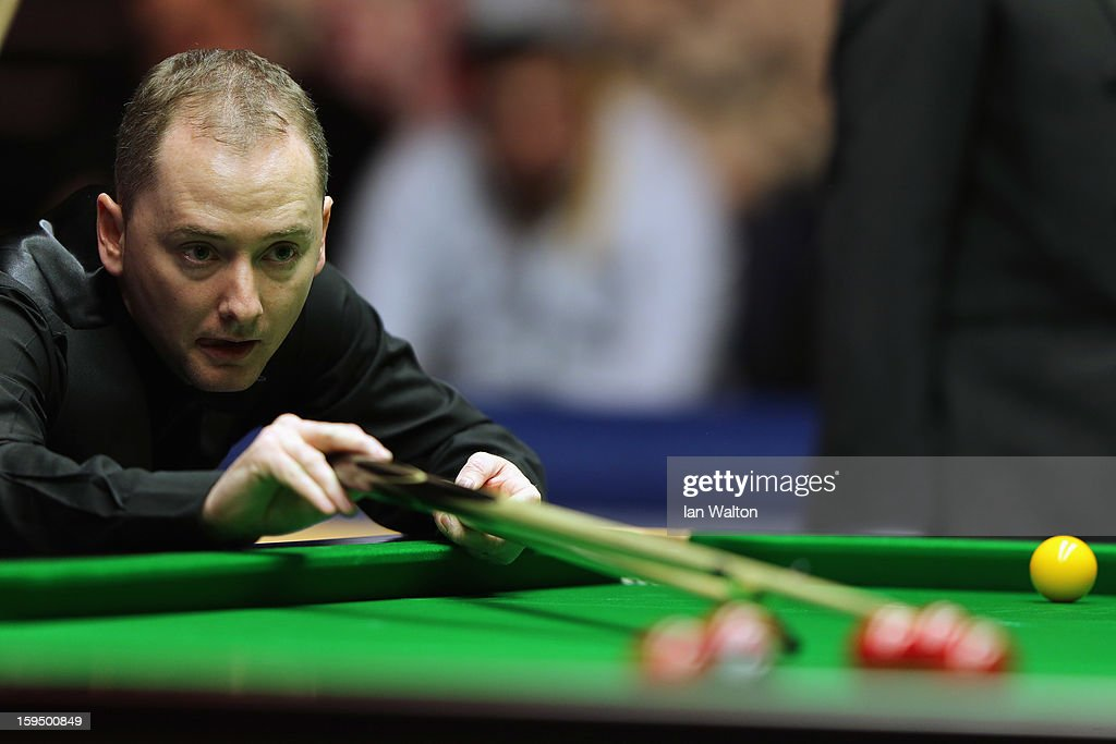 <a gi-track='captionPersonalityLinkClicked' href=/galleries/search?phrase=Graeme+Dott&family=editorial&specificpeople=657052 ng-click='$event.stopPropagation()'>Graeme Dott</a> of Scotland in action during his first round match against Stephen Maguire of Scotland at Alexandra Palace on January 14, 2013 in London, England.