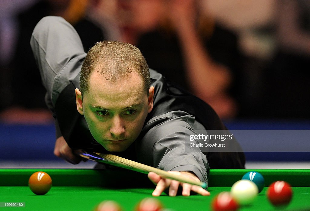 <a gi-track='captionPersonalityLinkClicked' href=/galleries/search?phrase=Graeme+Dott&family=editorial&specificpeople=657052 ng-click='$event.stopPropagation()'>Graeme Dott</a> of Scotland in action during his quarter-final match against Judd Trump of England on day 6 of The Masters at Alexandra Palace on January 18, 2013 in London England.