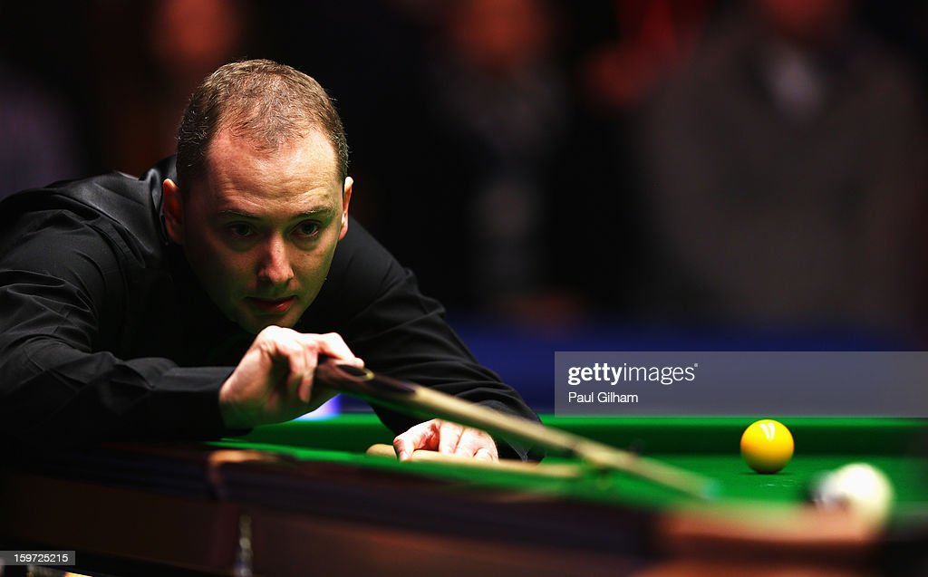 <a gi-track='captionPersonalityLinkClicked' href=/galleries/search?phrase=Graeme+Dott&family=editorial&specificpeople=657052 ng-click='$event.stopPropagation()'>Graeme Dott</a> of Scotland in action during the semi-final match between <a gi-track='captionPersonalityLinkClicked' href=/galleries/search?phrase=Graeme+Dott&family=editorial&specificpeople=657052 ng-click='$event.stopPropagation()'>Graeme Dott</a> of Scotland and Mark Selby of England at Alexandra Palace on January 19, 2013 in London, England.