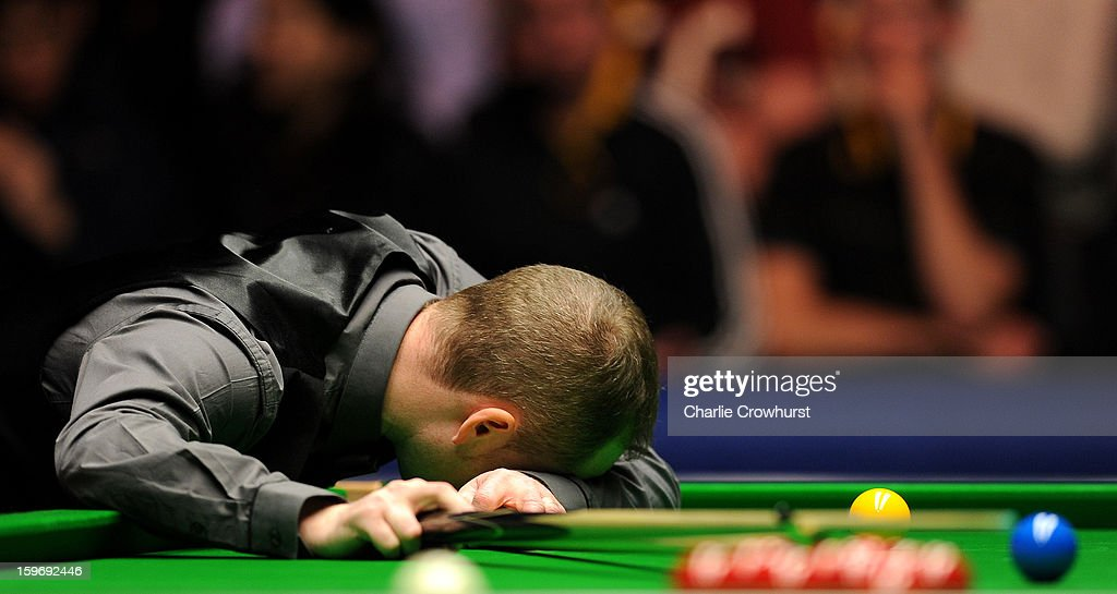 Graeme Dott of Scotland is dejected after missing an easy pot during his quarter-final match against Judd Trump of England on day 6 of The Masters at Alexandra Palace on January 18, 2013 in London England.
