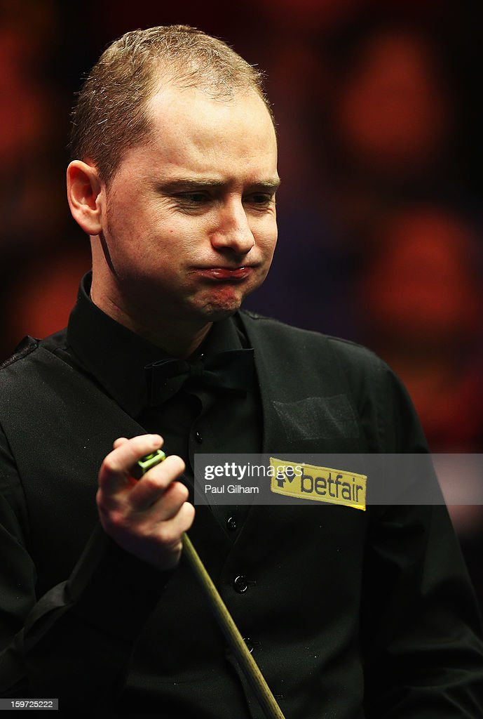 <a gi-track='captionPersonalityLinkClicked' href=/galleries/search?phrase=Graeme+Dott&family=editorial&specificpeople=657052 ng-click='$event.stopPropagation()'>Graeme Dott</a> of Scotland looks on during the semi-final match between <a gi-track='captionPersonalityLinkClicked' href=/galleries/search?phrase=Graeme+Dott&family=editorial&specificpeople=657052 ng-click='$event.stopPropagation()'>Graeme Dott</a> of Scotland and Mark Selby of England at Alexandra Palace on January 19, 2013 in London, England.