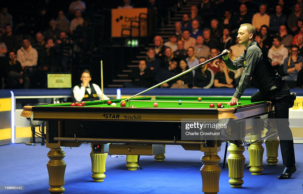 Graeme Dott of Scotland plays a tricky shot with a spider during his quarter-final match against Judd Trump of England on day 6 of The Masters at Alexandra Palace on January 18, 2013 in London England.