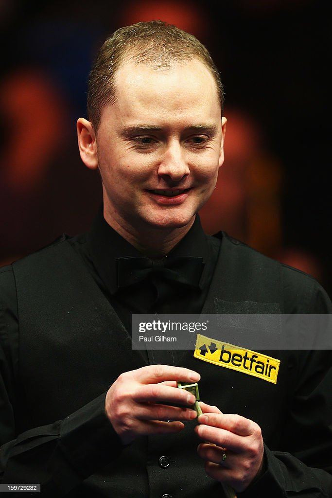 <a gi-track='captionPersonalityLinkClicked' href=/galleries/search?phrase=Graeme+Dott&family=editorial&specificpeople=657052 ng-click='$event.stopPropagation()'>Graeme Dott</a> of Scotland reacts during the semi-final match between <a gi-track='captionPersonalityLinkClicked' href=/galleries/search?phrase=Graeme+Dott&family=editorial&specificpeople=657052 ng-click='$event.stopPropagation()'>Graeme Dott</a> of Scotland and Mark Selby of England at Alexandra Palace on January 19, 2013 in London, England.