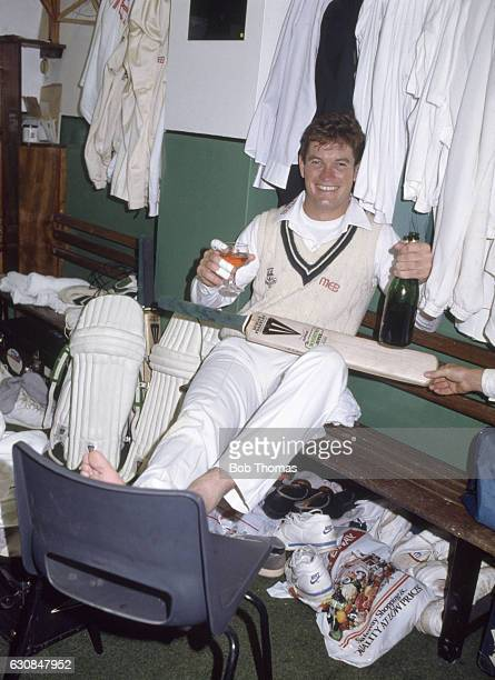 Graeme Hick of Worcestershire celebrates scoring 1000 runs before the end of May at Worcester on 28th May 1988