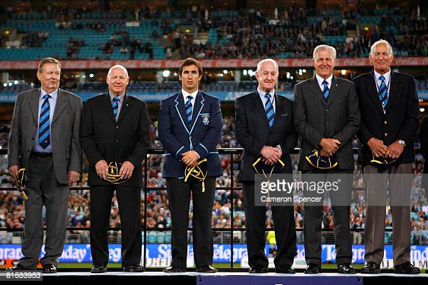 Graeme Langlands Bob Fulton Andrew Johns John Raper Ron Coote and Norm Provan pose on stage after being inducted into the NSW Team of the Century...