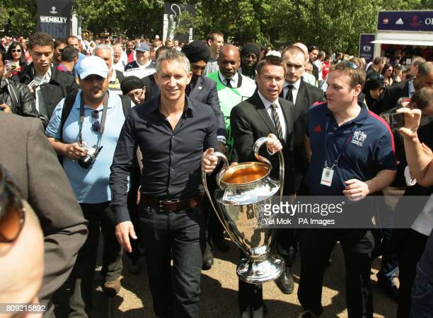 Graeme Le Saux and Gary Lineker carrying the UEFA Champions League Trophy during the official opening of the UEFA Champions Festival at Hyde Park in...