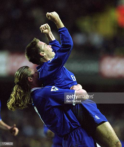 Graeme Le Saux of Chelsea celebrates his goal with teammate Emmanuel Petit during the AXA sponsored FA Cup quarter final match between Tottenham...