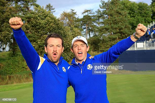 Graeme McDowell and Rory McIlroy of Europe celebrate winning the Ryder Cup after Jamie Donaldson of Europe defeated Keegan Bradley of the United...