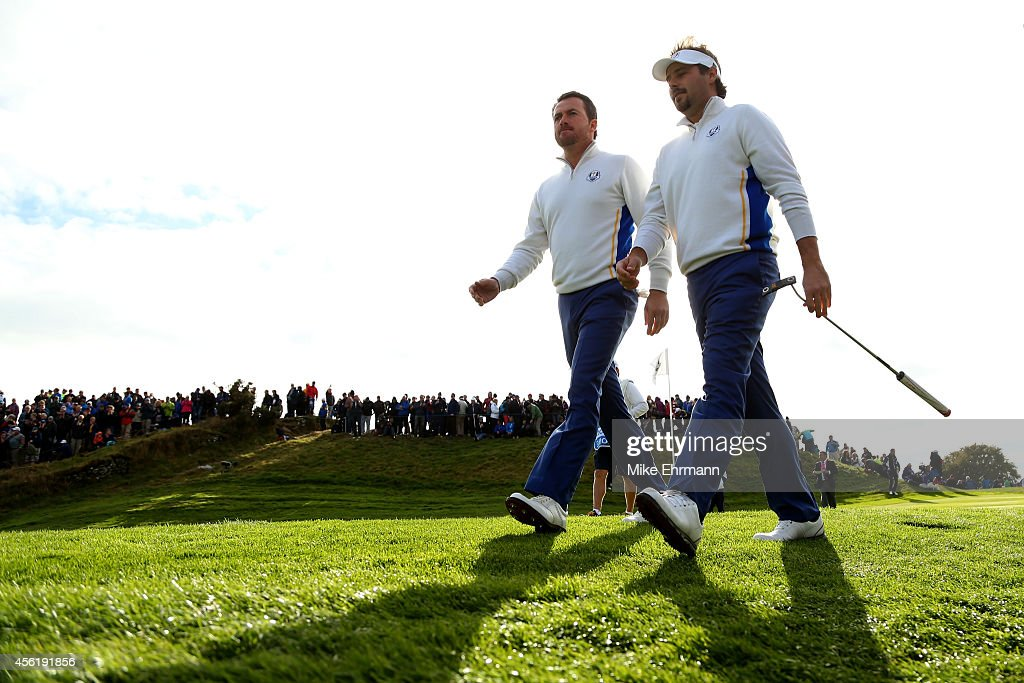 <a gi-track='captionPersonalityLinkClicked' href=/galleries/search?phrase=Graeme+McDowell+-+Golfer&family=editorial&specificpeople=196520 ng-click='$event.stopPropagation()'>Graeme McDowell</a> and <a gi-track='captionPersonalityLinkClicked' href=/galleries/search?phrase=Victor+Dubuisson&family=editorial&specificpeople=3333395 ng-click='$event.stopPropagation()'>Victor Dubuisson</a> of Europe walk down the 7th hole during the Afternoon Foursomes of the 2014 Ryder Cup on the PGA Centenary course at the Gleneagles Hotel on September 27, 2014 in Auchterarder, Scotland.