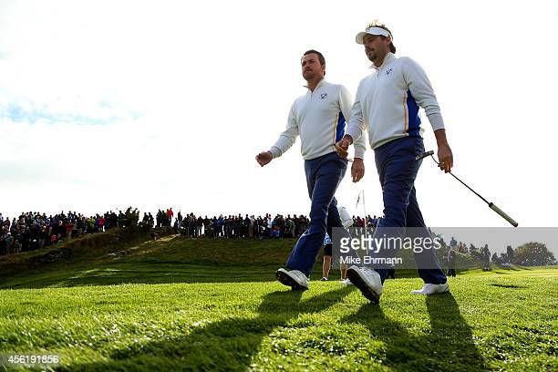 Graeme McDowell and Victor Dubuisson of Europe walk down the 7th hole during the Afternoon Foursomes of the 2014 Ryder Cup on the PGA Centenary...