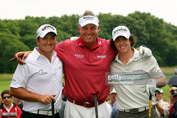 Graeme McDowell Darren Clarke and Rory McIlroy of Northern Ireland pose together during the second day of previews to the 109th US Open on the Black...