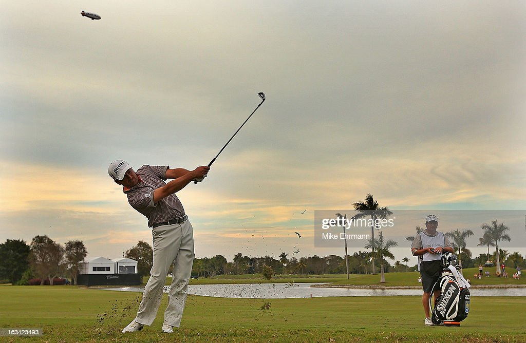 Graeme McDowell hits his approach shot on the 18th hole during the third round of the WGC-Cadillac Championship at the Trump Doral Golf Resort & Spa in on March 9, 2013 in Doral, Florida.
