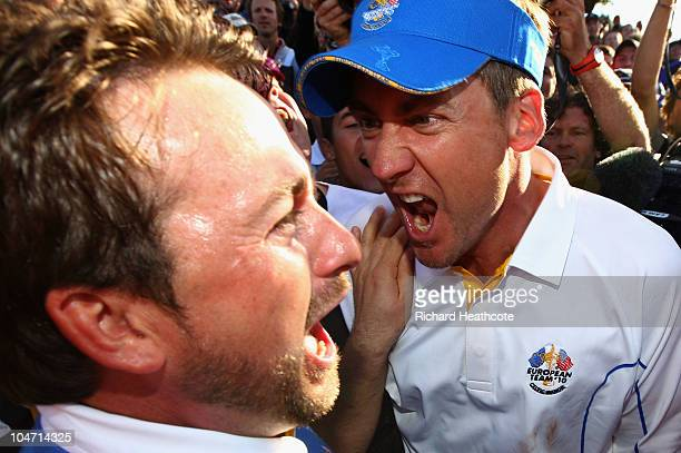 Graeme McDowell of Europe celebrates his 31 win to secure victory for the European team on the 17th green with Ian Poulter in the singles matches...