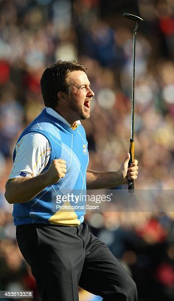 Graeme McDowell of Europe celebrates his birdie putt on the 16th green in the singles matches during the 2010 Ryder Cup at the Celtic Manor Resort on...