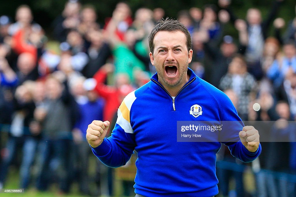 <a gi-track='captionPersonalityLinkClicked' href=/galleries/search?phrase=Graeme+McDowell&family=editorial&specificpeople=196520 ng-click='$event.stopPropagation()'>Graeme McDowell</a> of Europe celebrates victory against Jordan Spieth of the United States on the 17th hole during the Singles Matches of the 2014 Ryder Cup on the PGA Centenary course at the Gleneagles Hotel on September 28, 2014 in Auchterarder, Scotland.