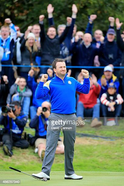 Graeme McDowell of Europe celebrates victory against Jordan Spieth of the United States on the 17th hole during the Singles Matches of the 2014 Ryder...
