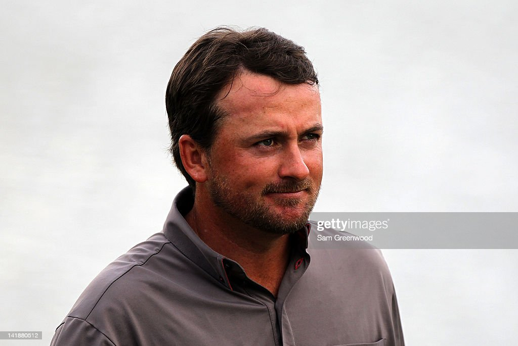 <a gi-track='captionPersonalityLinkClicked' href=/galleries/search?phrase=Graeme+McDowell+-+Golfer&family=editorial&specificpeople=196520 ng-click='$event.stopPropagation()'>Graeme McDowell</a> of Ireland acknowledges the crowd on the 18th hole during the third round of the Arnold Palmer Invitational presented by MasterCard at the Bay Hill Club and Lodge on March 24, 2012 in Orlando, Florida.