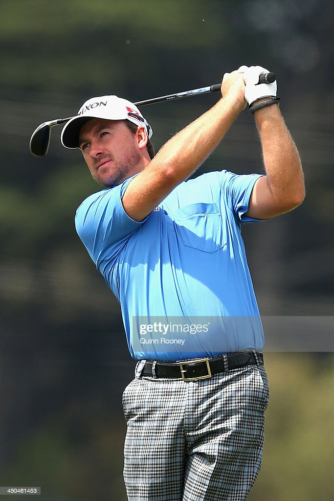 <a gi-track='captionPersonalityLinkClicked' href=/galleries/search?phrase=Graeme+McDowell&family=editorial&specificpeople=196520 ng-click='$event.stopPropagation()'>Graeme McDowell</a> of Ireland plays an approach shot during practice ahead of the World Cup Of Golf at Royal Melbourne Golf Course on November 19, 2013 in Melbourne, Australia.