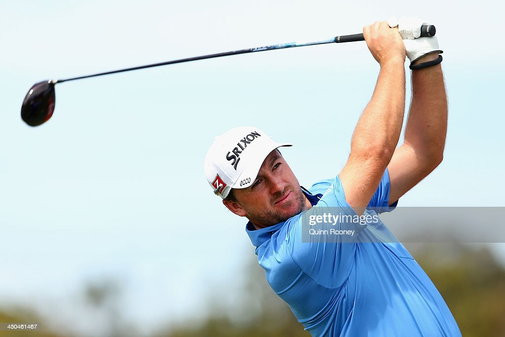 <a gi-track='captionPersonalityLinkClicked' href=/galleries/search?phrase=Graeme+McDowell&family=editorial&specificpeople=196520 ng-click='$event.stopPropagation()'>Graeme McDowell</a> of Ireland tees off during practice ahead of the World Cup Of Golf at Royal Melbourne Golf Course on November 19, 2013 in Melbourne, Australia.
