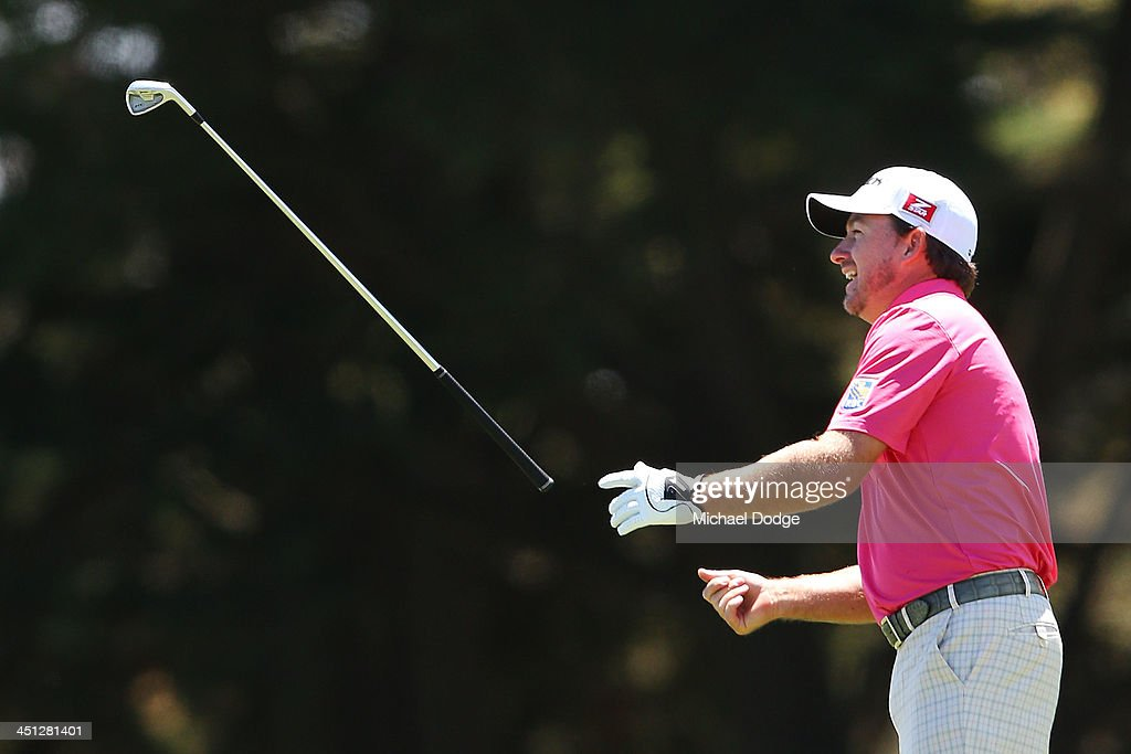 <a gi-track='captionPersonalityLinkClicked' href=/galleries/search?phrase=Graeme+McDowell+-+Golfer&family=editorial&specificpeople=196520 ng-click='$event.stopPropagation()'>Graeme McDowell</a> of Ireland throws his iron after an approach shot on the 10th hole during day two of the World Cup of Golf at Royal Melbourne Golf Course on November 22, 2013 in Melbourne, Australia.