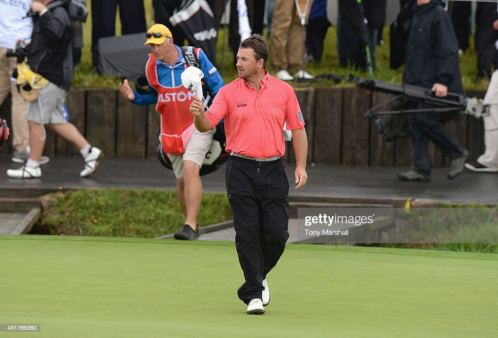 <a gi-track='captionPersonalityLinkClicked' href=/galleries/search?phrase=Graeme+McDowell+-+Golfer&family=editorial&specificpeople=196520 ng-click='$event.stopPropagation()'>Graeme McDowell</a> of Northern Ireland acknowledges the crowd as he walks on to the 18th green during the Alstom Open de France - Day Four at Le Golf National on July 6, 2014 in Paris, France.