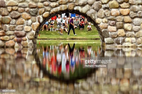Graeme McDowell of Northern Ireland and caddie Ken Combos walk to the third green during the third round of the World Golf Championships Bridgestone...
