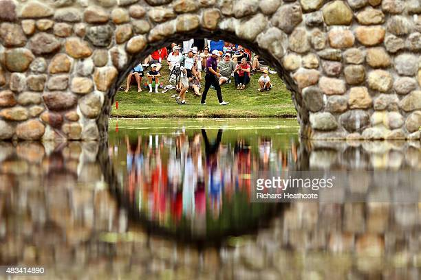 Graeme McDowell of Northern Ireland and caddie Ken Combos walk to the third green during the third round of the World Golf Championships Bridgestone...