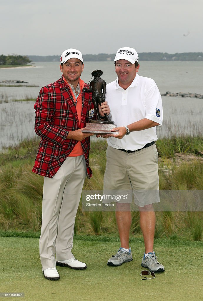 Graeme McDowell of Northern Ireland and his caddie Ken Comboy during the final round of the RBC Heritage at Harbour Town Golf Links on April 21, 2013 in Hilton Head Island, South Carolina.