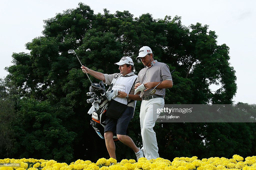 Graeme McDowell of Northern Ireland and his caddie Ken Comboy walk on the 15th hole during the third round of the World Golf Championships-Cadillac Championship at the Trump Doral Golf Resort & Spa on March 9, 2013 in Doral, Florida.