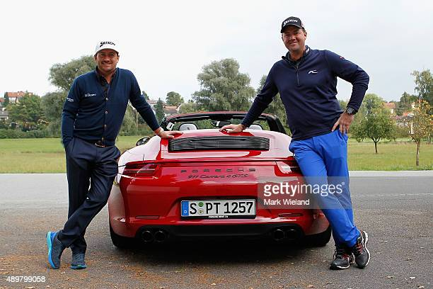 Graeme McDowell of Northern Ireland and Peter Hanson of Sweden take a Porsche Carrera 911 4 GTS for a test drive after the first round of the Porsche...