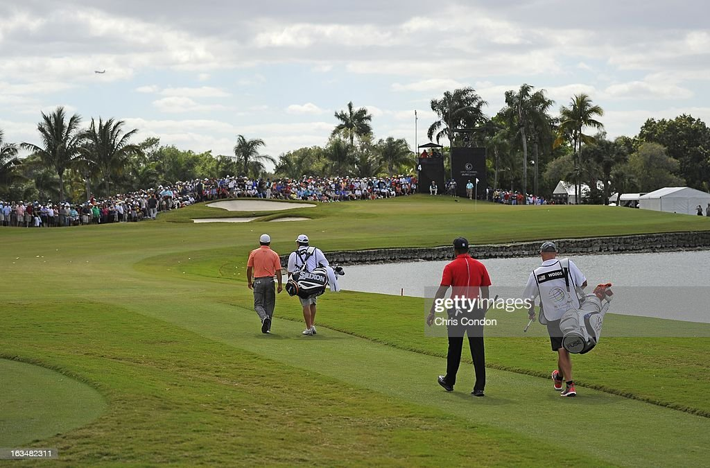 Graeme McDowell of Northern Ireland and Tiger Woods walk off the 4th tee during the final round of the World Golf Championships-Cadillac Championship at TPC Blue Monster at Doral on March 10, 2013 in Doral, Florida.