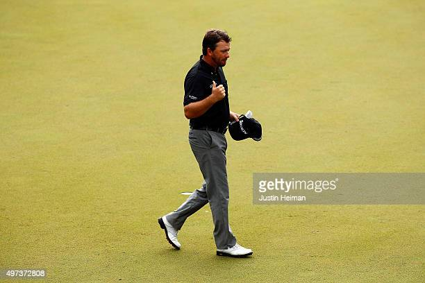 Graeme McDowell of Northern Ireland celebrates on the 18th hole green after winning the three man playoff in the final round of the OHL Classic at...