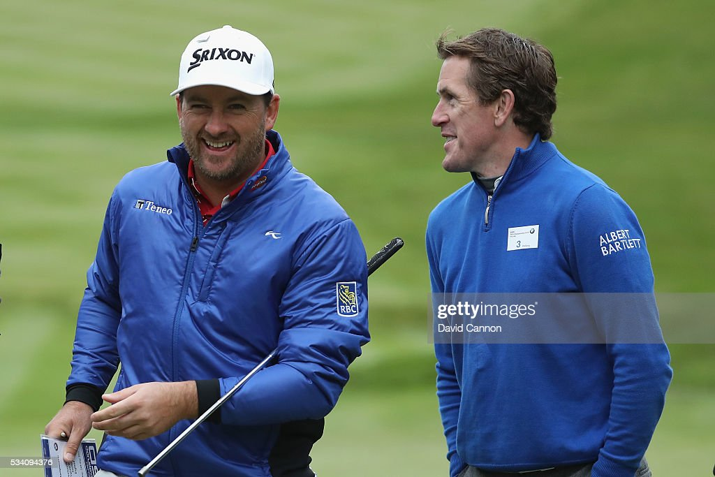 <a gi-track='captionPersonalityLinkClicked' href=/galleries/search?phrase=Graeme+McDowell&family=editorial&specificpeople=196520 ng-click='$event.stopPropagation()'>Graeme McDowell</a> of Northern Ireland chats with Jockey Sir Anthony McCoy during the Pro-Am prior to the BMW PGA Championship at Wentworth on May 25, 2016 in Virginia Water, England.