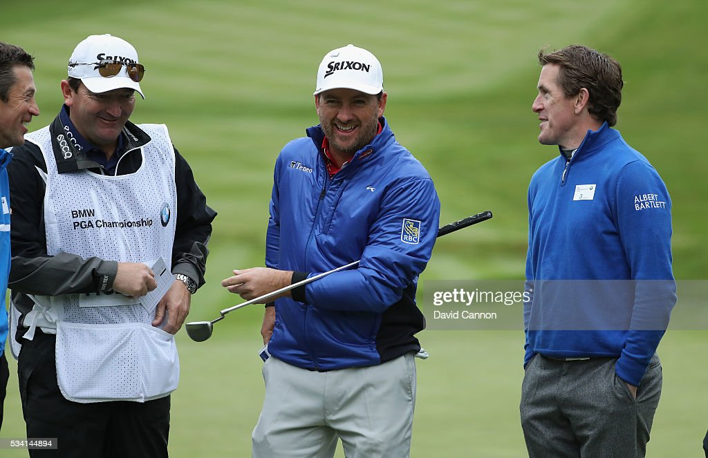 Graeme McDowell of Northern Ireland chats with Jockey Sir Anthony McCoy during the Pro-Am prior to the BMW PGA Championship at Wentworth on May 25, 2016 in Virginia Water, England.