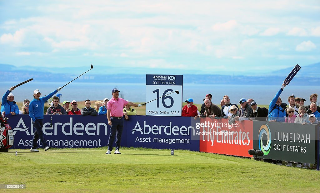 Graeme McDowell of Northern Ireland, <a gi-track='captionPersonalityLinkClicked' href=/galleries/search?phrase=Emiliano+Grillo&family=editorial&specificpeople=7291586 ng-click='$event.stopPropagation()'>Emiliano Grillo</a> of Argentina and volunteers react to a tee shot by McDowell on the 16th tee during the final round of the Aberdeen Asset Management Scottish Open at Gullane Golf Club on July 12, 2015 in Gullane, East Lothian, Scotland.