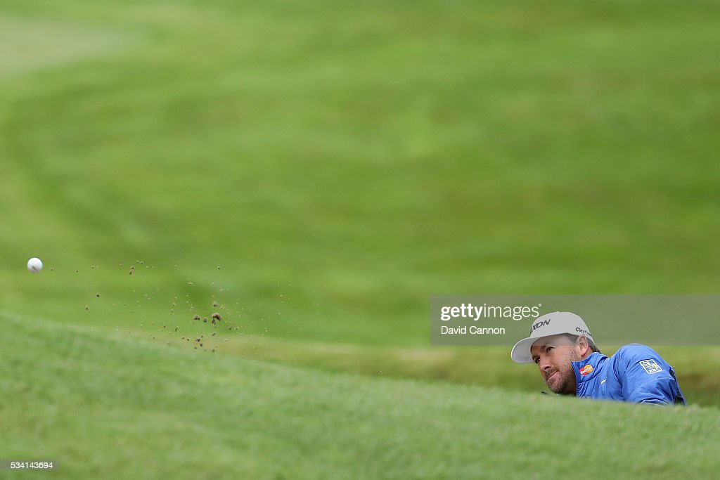 <a gi-track='captionPersonalityLinkClicked' href=/galleries/search?phrase=Graeme+McDowell&family=editorial&specificpeople=196520 ng-click='$event.stopPropagation()'>Graeme McDowell</a> of Northern Ireland hits a bunker shot during the Pro-Am prior to the BMW PGA Championship at Wentworth on May 25, 2016 in Virginia Water, England.