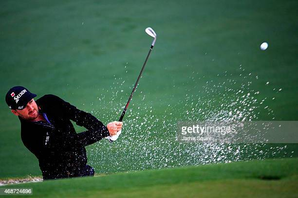 Graeme McDowell of Northern Ireland hits a shot from a bunker during a practice round prior to the start of the 2015 Masters Tournament at Augusta...