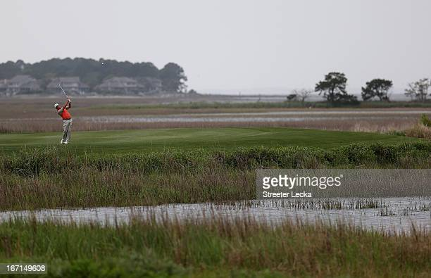 Graeme McDowell of Northern Ireland hits a shot from the 18th fairway in a playoff against Webb Simpson during the final round of the RBC Heritage at...
