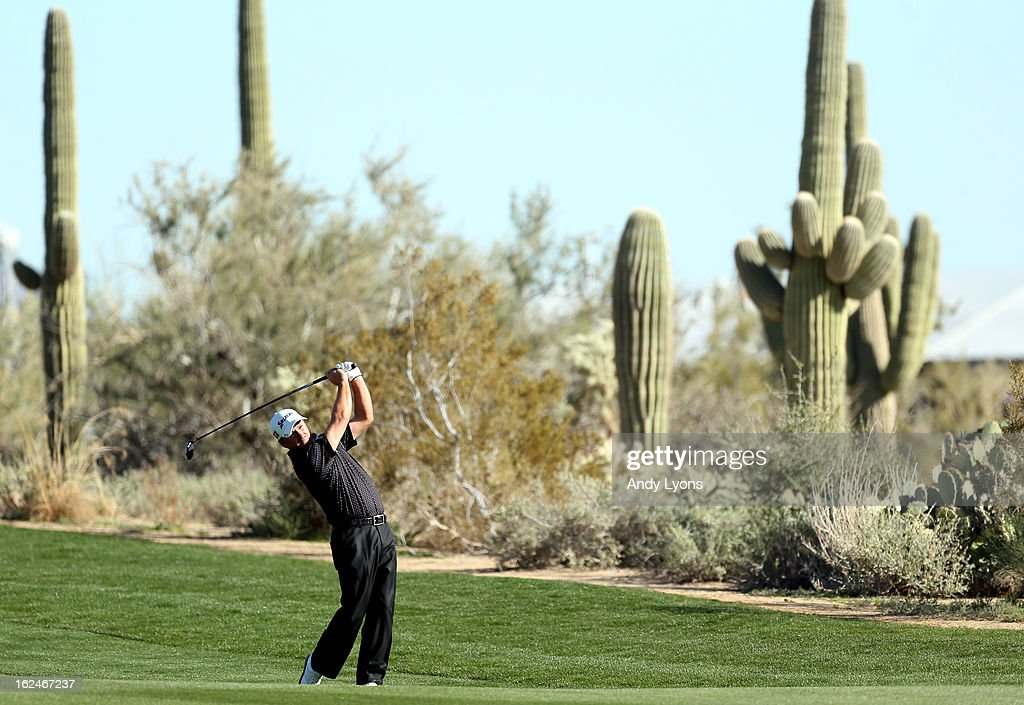 Graeme McDowell of Northern Ireland hits a shot from the fairway on the 11th hole during the quarterfinal round of the World Golf Championships - Accenture Match Play at the Golf Club at Dove Mountain on February 23, 2013 in Marana, Arizona.