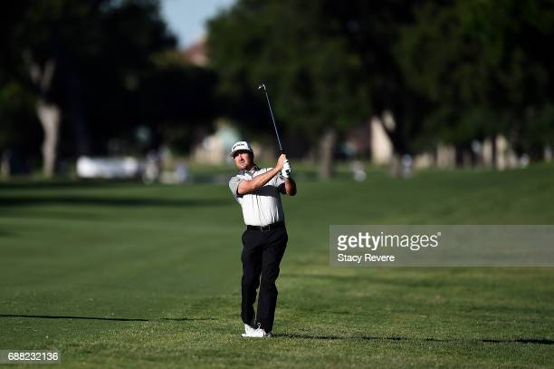 Graeme McDowell of Northern Ireland hits a shot on the 11th hole during Round One of the DEAN DELUCA Invitational at Colonial Country Club on May 25...