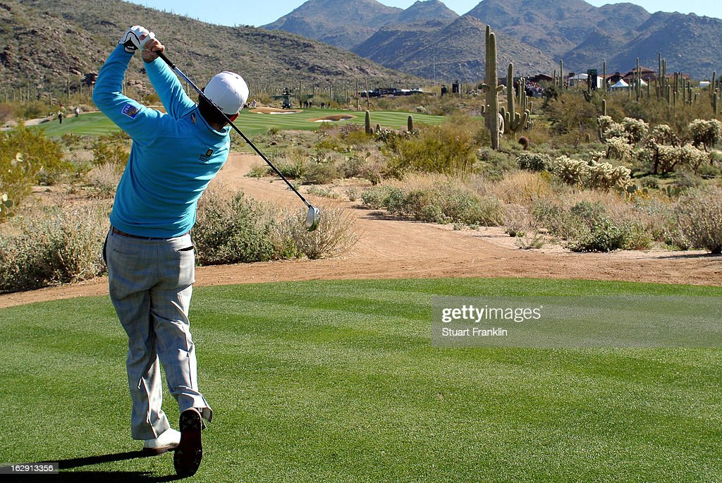 Graeme McDowell of Northern Ireland hits a tee shot during the third round of the World Golf Championships - Accenture Match Play at the Golf Club at Dove Mountain on February 23, 2013 in Marana, Arizona.