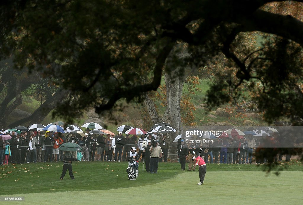 <a gi-track='captionPersonalityLinkClicked' href=/galleries/search?phrase=Graeme+McDowell&family=editorial&specificpeople=196520 ng-click='$event.stopPropagation()'>Graeme McDowell</a> of Northern Ireland hits from the fairway on the fifth hole during the final round of the Tiger Woods World Challenge Presented by Northwestern Mutual at Sherwood Country Club on December 2, 2012 in Thousand Oaks, California.