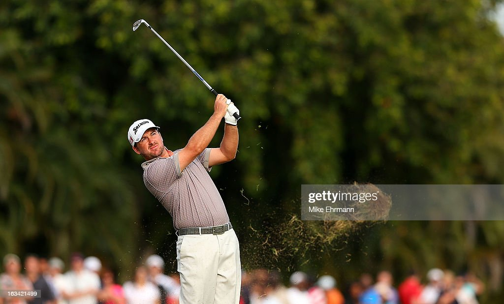 Graeme McDowell of Northern Ireland hits his approach shot on the 14th hole during the third round of the World Golf Championships-Cadillac Championship at the Trump Doral Golf Resort & Spa on March 9, 2013 in Doral, Florida.