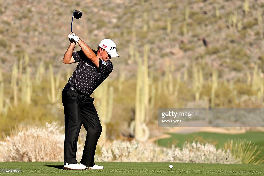 Graeme McDowell of Northern Ireland hits his tee shot on the 15th hole during the quarterfinal round of the World Golf Championships - Accenture Match Play at the Golf Club at Dove Mountain on February 23, 2013 in Marana, Arizona.