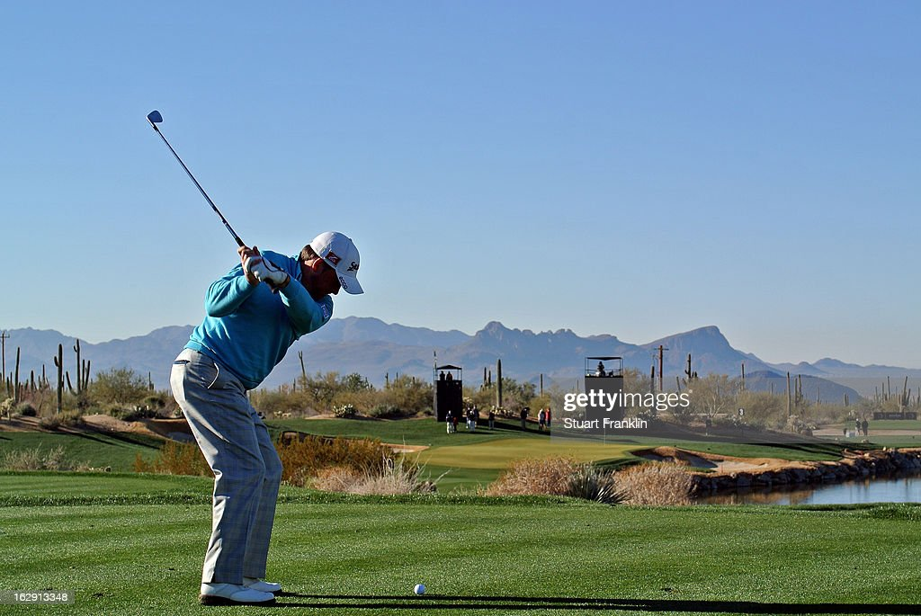 Graeme McDowell of Northern Ireland hits his tee shot on the third hole during the third round of the World Golf Championships - Accenture Match Play at the Golf Club at Dove Mountain on February 23, 2013 in Marana, Arizona.