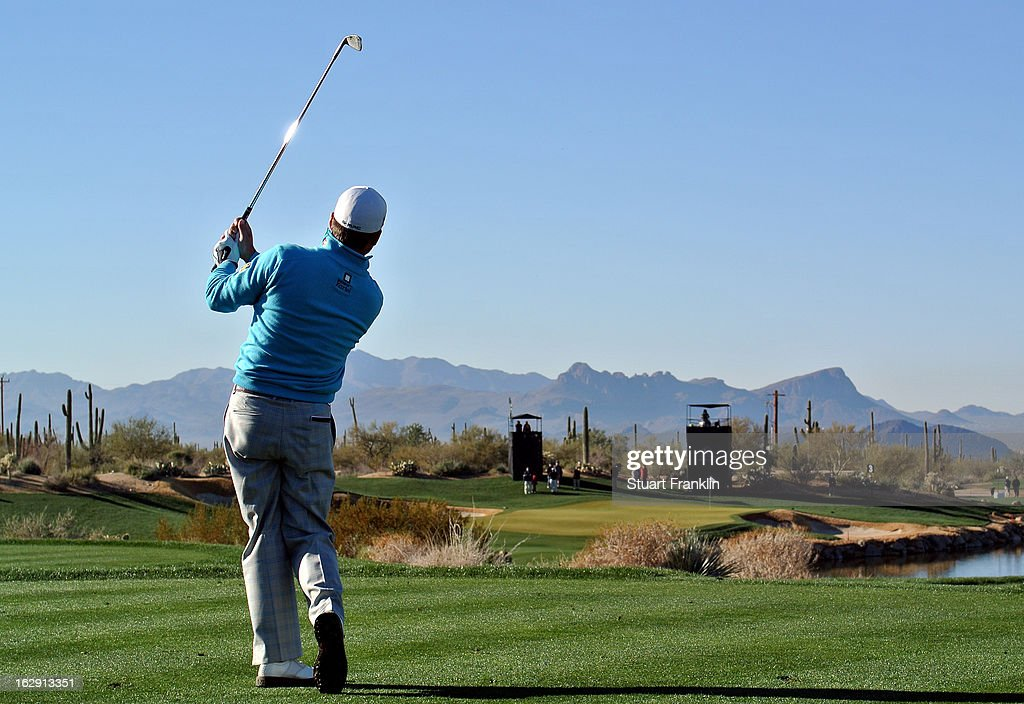 <a gi-track='captionPersonalityLinkClicked' href=/galleries/search?phrase=Graeme+McDowell+-+Golfer&family=editorial&specificpeople=196520 ng-click='$event.stopPropagation()'>Graeme McDowell</a> of Northern Ireland hits his tee shot on the third hole during the third round of the World Golf Championships - Accenture Match Play at the Golf Club at Dove Mountain on February 23, 2013 in Marana, Arizona.