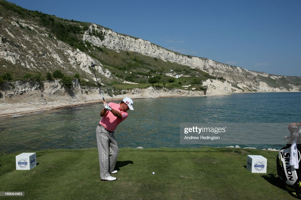 <a gi-track='captionPersonalityLinkClicked' href=/galleries/search?phrase=Graeme+McDowell&family=editorial&specificpeople=196520 ng-click='$event.stopPropagation()'>Graeme McDowell</a> of Northern Ireland hits his tee-shot on the ninth hole during the Volvo World Match Play Championship at Thracian Cliffs Golf & Beach Resort on May 19, 2013 in Kavarna, Bulgaria.