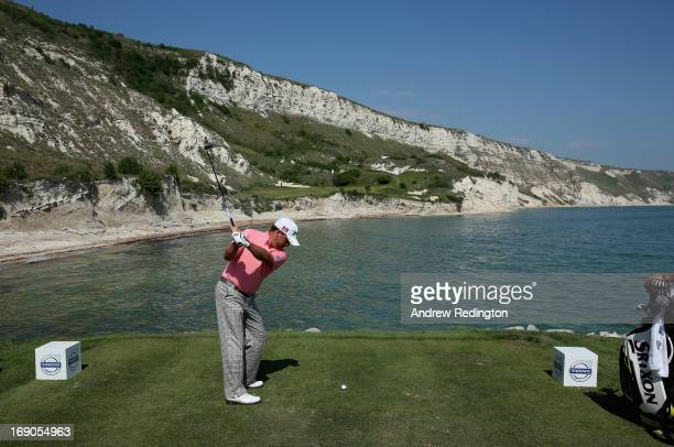 Graeme McDowell of Northern Ireland hits his teeshot on the ninth hole during the Volvo World Match Play Championship at Thracian Cliffs Golf Beach...